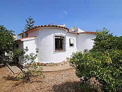 Costa Blanca near Denia in Spain, one storey detached house for sale at a low price, new like property with orange trees, within an almost rural setting